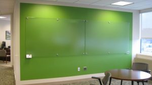 clear-board-on-green-wall