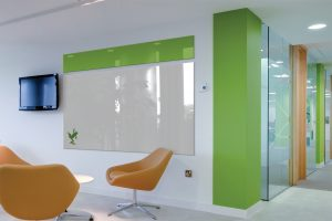 modern-office-design-in-white-green-tone-with-large-green-white-glass-dry-erase-board-from-ikea-with-comfortable-yellow-chairs